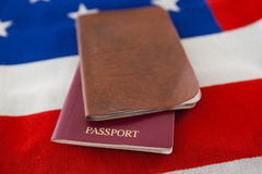 Passport and visa on an American flag. Close-up of passport and visa on an American flag stock photography