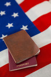 Passport and visa on an American flag. Close-up of passport and visa on an American flag royalty free stock photo