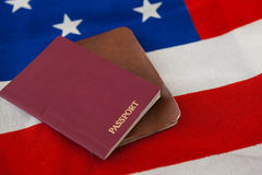 Passport and visa on an American flag. Close-up of passport and visa on an American flag royalty free stock photos