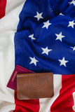 Passport and visa on an American flag. Close-up of passport and visa on an American flag royalty free stock images