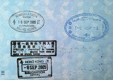 Passport Visa Stamps. Visa stamps in a passport: Hong Kong and Egypt Stock Photos
