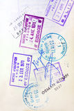 Passport Visa Stamps. Old visa stamps on a passport page.  Includes stamps from Spain, Turkey, Bulgaria and Greece Stock Photography