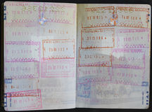 Passport visa and stamps. Different passport controll stamps on two pages of Lithuanian passport Royalty Free Stock Photo