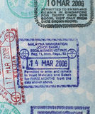Passport Visa Stamps-Malaysia. Visa stamps in a passport: Malaysia and Singapore Royalty Free Stock Image