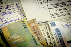 Passport Visas and Currency Stock Photos