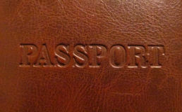 Passport. Word engraved on a leather Royalty Free Stock Photo