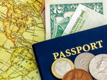 Passport with world currency and map. Blue passport with world currency and map of america Royalty Free Stock Photo