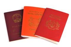 Passports. Singapore, Malaysia, China passports isolated on white background stock photo