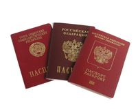 Passports. Soviet,foreign and national of Russian Federation passports on white isolated Royalty Free Stock Images