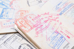 Passports. Opened passports with country stamps royalty free stock photos