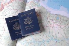 Passports. Two passports on an atlas Royalty Free Stock Photo