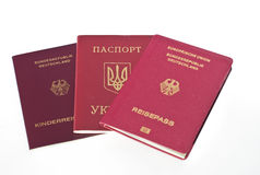 Passports. Three different passports isolated on white Stock Photo