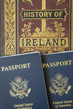 Passports ancient history book travel concept. Overseas travel from America to historical sites and history study of ancient book with USA passports Royalty Free Stock Images