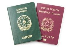 Passports. Azeri and Italian passports on a white background royalty free stock images