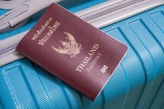 Passports on blue travel bag Stock Photos