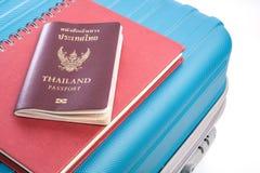 Passports on blue travel bag Stock Photo