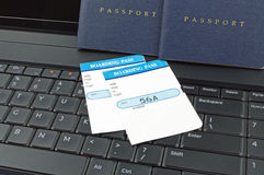 Passports boarding pass and computer Royalty Free Stock Photos