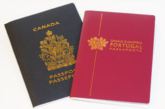 Passports - Duo Citizenship. An image of a Canadian passport and a Portuguese passport representing duo citizenship stock images