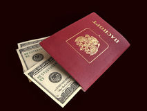 Passports with enclosed in inside dollars Royalty Free Stock Images