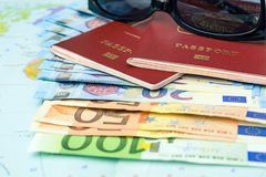 Passports with european union currency and sunglasses on a map background. Travel concept Stock Photos