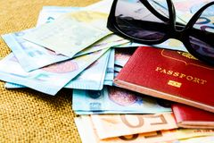 Passports with european union currency and sunglasses on a map background. Travel concept. Royalty Free Stock Image