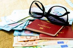 Passports with european union currency and sunglasses on a map background. Travel concept. Royalty Free Stock Images