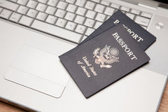 Passports on Laptop Keyboard Royalty Free Stock Images
