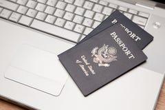 Passports on Laptop Keyboard Royalty Free Stock Images