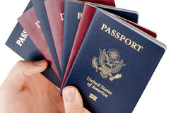 7 passports. Man holds bunch of passports, USA passport on the front royalty free stock images