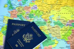 Passports on map-1. Passports on a world map centered on Europe Royalty Free Stock Photo