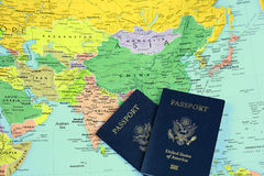 Passports on map-2. Passports on a world map centered on asia Royalty Free Stock Images