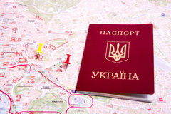 Passports on a map of the Rome. Ukrainian passports on a map of the Rome Royalty Free Stock Photos