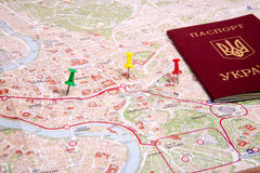 Passports on a map of the Rome. Ukrainian passports on a map of the Rome Stock Photos