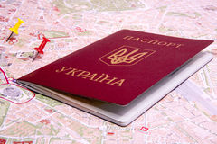 Passports on a map of the Rome. Ukrainian passports on a map of the Rome Stock Photo