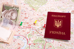 Passports on a map of the Rome. Ukrainian passports on a map of the Rome Royalty Free Stock Photography