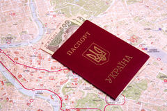 Passports on a map of the Rome. Ukrainian passports on a map of the Rome Stock Photography