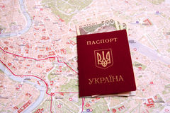 Passports on a map of the Rome. Ukrainian passports on a map of the Rome Royalty Free Stock Photo