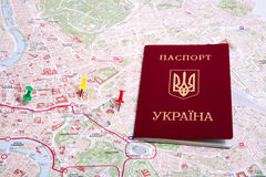 Passports on a map of the Rome. Ukrainian passports on a map of the Rome Stock Images