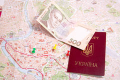 Passports on a map of the Rome. Ukrainian passports on a map of the Rome Royalty Free Stock Image