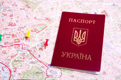 Passports on a map of the Rome. Ukrainian passports on a map of the Rome Royalty Free Stock Images