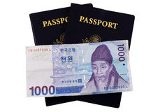 Passports and Money. US Passports with Korean Money Stock Photo