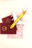 Passports and plane. Travelling symbols: three passports full of stamps and plane Stock Image