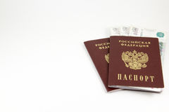 The passports of the Russian Federation and money on a white bac Stock Photos