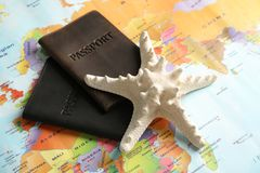 Passports and sea star on world map. Travel agency. Passports and sea star on world map, closeup. Travel agency royalty free stock image