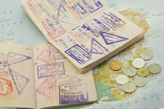 Passports. With stamps and coins on the map stock photo