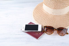 Passports with sunglasses, a hat and a smartphone. Stock Photography