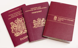 The passports of travelers. Passports Kingdom of Great Britain and Northern Ireland, the Netherlands and Sweden Stock Image
