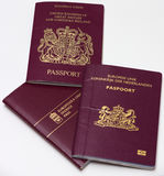 The passports of travelers. Passports Kingdom of Great Britain and Northern Ireland, the Netherlands and Sweden Royalty Free Stock Photo