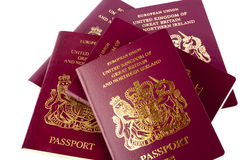 Passports on White Background. A stack of old and new UK passports isolated on a white background Royalty Free Stock Photo