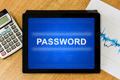 Password on digital tablet. With calculator and financial graph Stock Image